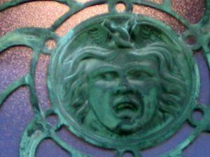 Asbury Park bas relief, copper sun face, carousel