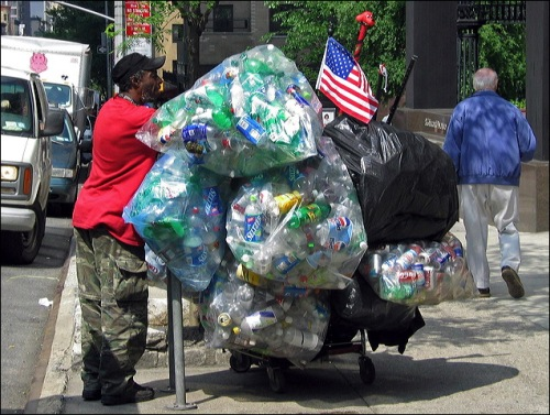 homeless man, streets of New York, recycle cans, American flag