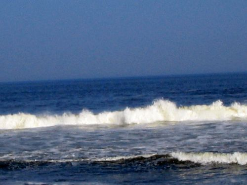 Hurricane Earl, waves, stone jetty, beach, foam