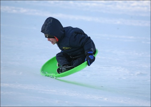Central Park, New York City, snow, sliding, saucer