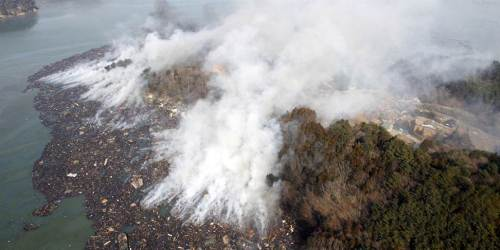 smoke rises, Japan's coast, Ishimaki,Japan, earthquake, tsunami March