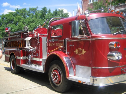 fourth of July parade, volunteer firemen, vintage fire truck