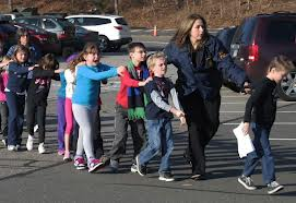 Children being led out of Newtown school