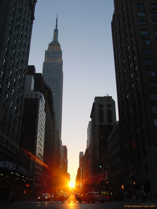 Sunset looking down 34th Street. One of two days when the sunset is exactly aligned with the grid of streets in Manhattan. Copyright © 2001, Neil deGrasse Tyson